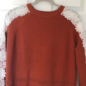 Listicle size Lg summer sweater with lace piping.